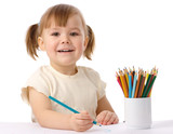 Fototapety Cute child draws with color pencils