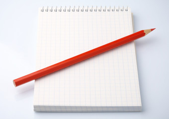 Blank notepad and a pencil