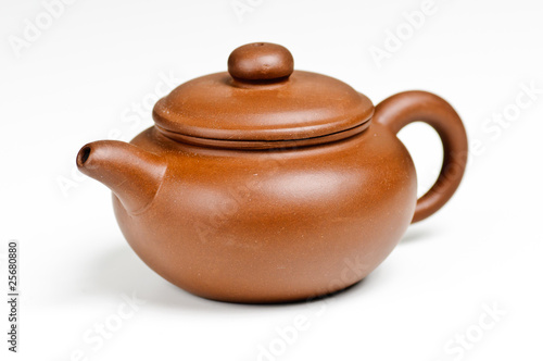 Clay tea pot on white background