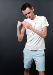Skinny man showing his muscles