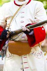 Soldier with carabiner and jacket during the re-enactment of the