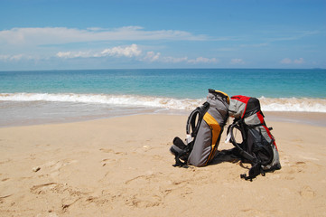 Two backpacks on the tropical beach