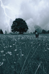 woman in the meadow with umbrella