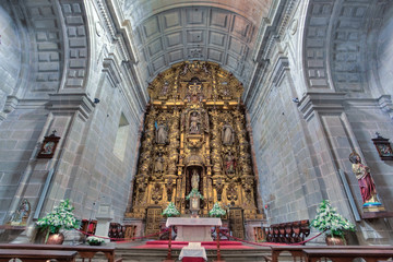 Gold altare inside church in Mosteiro de Poio in Spain