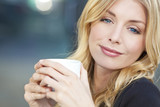 Beautiful Blond Woman Drinking Coffee or Tea