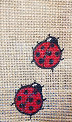 Ladybugs painted on canvas