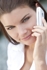 Beautiful Young Woman With Green Eyes On Cell Phone