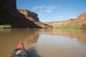 Bow of a kayak in a desert river