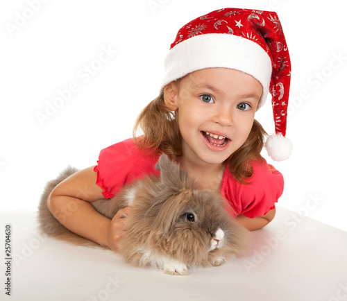 Child in the New Year hat with a rabbit.