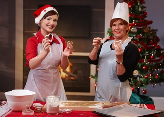 Mother and daughter at baking for christmas