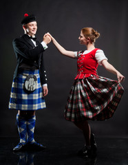 The pair dancing the Scottish dance in a kilt