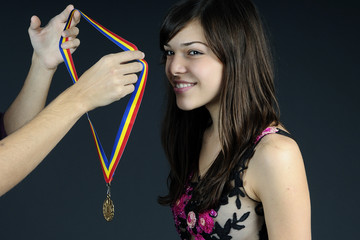 young sportive receiving golden medal