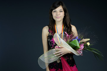 successful girl holding flowers