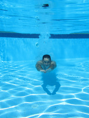 swimming underwater photo