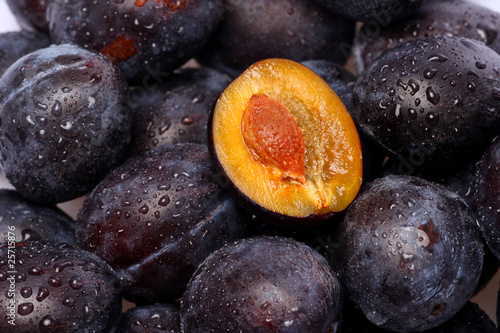 fresh plums with water pearls