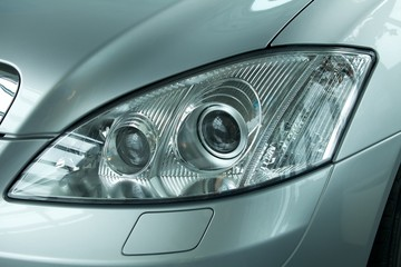 Close-up of headlight of car