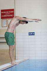 Swimmer about to jump into pool