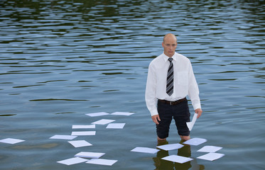 Portrait of businessman standing in lake