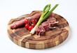 Raw pork tenderloin and vegetables