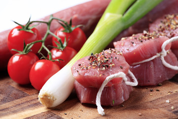 Raw pork tenderloin and vegetables