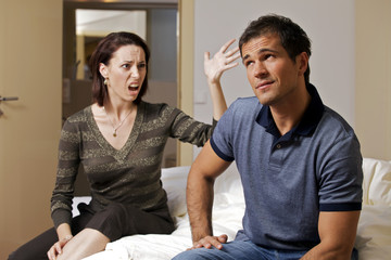 Young arguing with her husband in hotel room