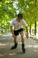 Young man riding roller skates