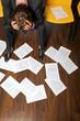 despeir businessman, documents scattered on floor