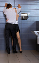 Young business couple in love at office washroom