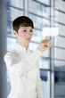 futuristic businesswoman office finger touch pad