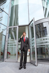 businessman at office exterior talking on cellphone