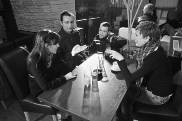 Group of young people in cafe