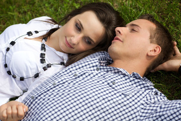 Young couple relaxing on grass