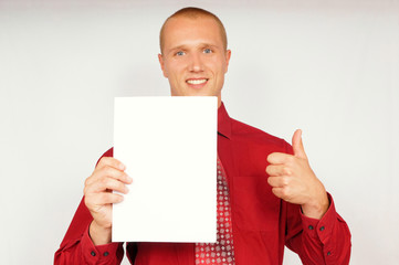 Young businessman in red shirt shows a document