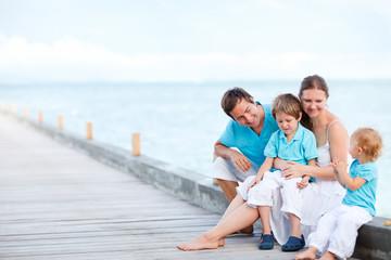 Family sitting outdoors at seashore