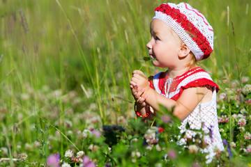 Portrait of toddler girl in meadow