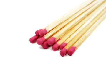 Heap of long wooden matches isolated on white background.