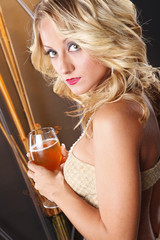 Close up of blond with cold rose wine