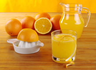 Fresh orange juice with orange juice squeezer (Selective Focus)