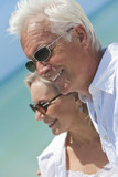 Fototapety Happy Senior Couple Looking To Sea on A Tropical Beach