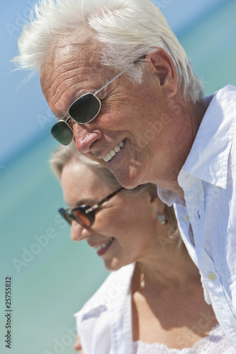 Happy Senior Couple Looking To Sea on A Tropical Beach