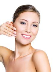 Woman pinching skin on her cheek