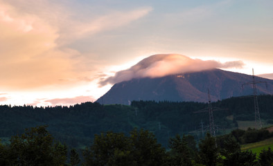 cloud sitting on top of Slovak mountain, sunset