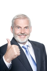 Senior businessman portrait thumb up