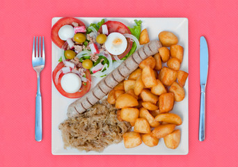 wratwurst with sauerkraut salad and potatoes