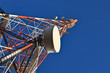 Telecommunication mast with microwave link and TV antennas.