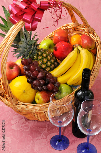 Fruit basket and a bottle of wine