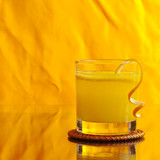 Fresh orange juice on orange background (Selective Focus)