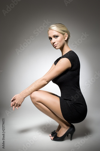 blonde in black dress