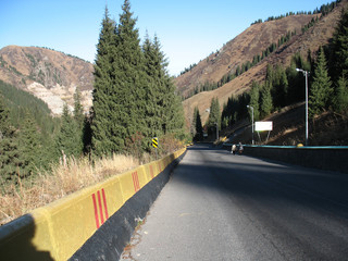mountain, sky, trees and road