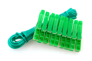 green clothes pegs and washing line